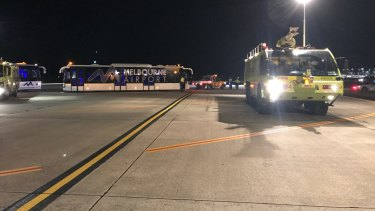A police vehicle on the tarmac after a man allegedly tried to enter the cockpit of Malaysia Airlines Flight MH128.