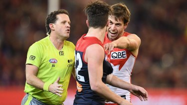 Sydney players remonstrate with Tomas Bugg.