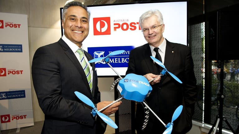 Australia Post CEO Ahmed Fahour and University of Melbourne vice-chancellor Glyn Davis. The postal service will trial drone deliveries next year.