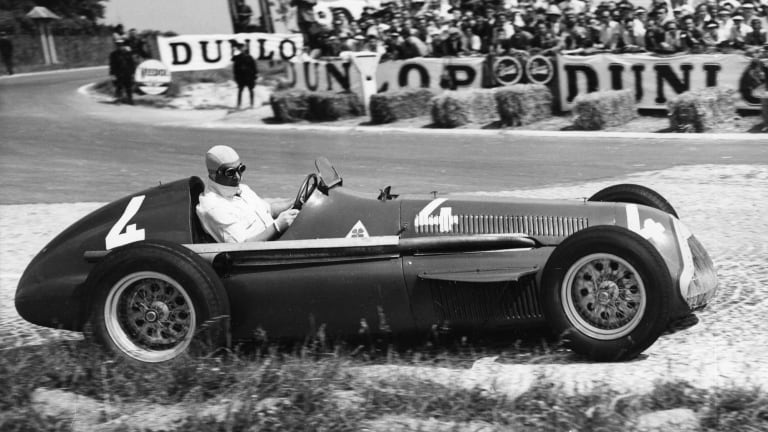 Juan Manuel Fangio comes out of a bend at speed in July, 1951.