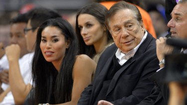Outrage: Los Angeles Clippers owner Donald Sterling (right) with girlfriend V. Stiviano (left).