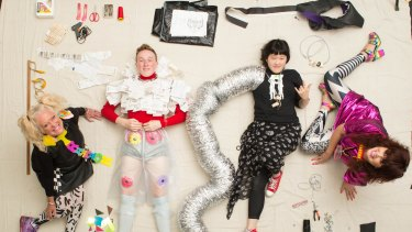 """Jenny Bannister and Lia Tabrah (sitting) are teaching young people to create fashion from trash - """"trashion"""" - seen here with Matthew Coyne and Lily Duan."""