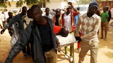 A man injured in a suicide blast in Potiskum is taken to hospital.