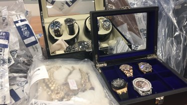 Police have seized hundreds of items, including watches, cars, motorbikes, airplanes, properties and cash.
