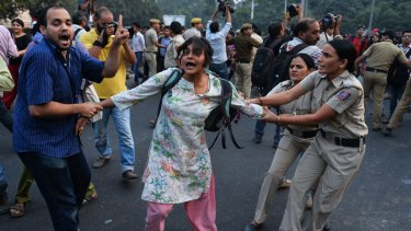 Indian police in Delhi attempt to stop 'Kiss of Love' protesters from marching on the headquarters of the RSS, a Hindu nationalist organisation linked to India's ruling Bharatiya Janata Party.