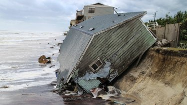 """A house slides into the ocean in the aftermath of Hurricane Irma in Ponte Vedra Beach, Florida. The Pope warns the world will """"go down"""" if we ignore climate change."""