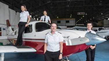 Women flying high: Pilot Tessa Beyersdorff with collegues Steph Barry, Amelia Andermahr and Kara Eggleston at Bankstown Airport's Sydney Flying School.