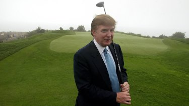Donald Trump, pictured on one of his golf courses in 2002, has business interests around the world.