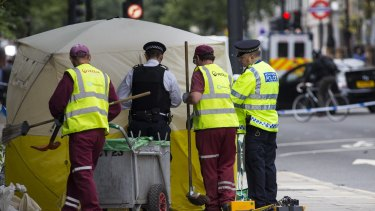 Police officers and cleaners tend to the scene of a knife attack in Russell Square on Thursday.