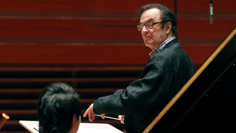 Charles Dutoit, right, performs with the Philadelphia Orchestra during a rehearsal.
