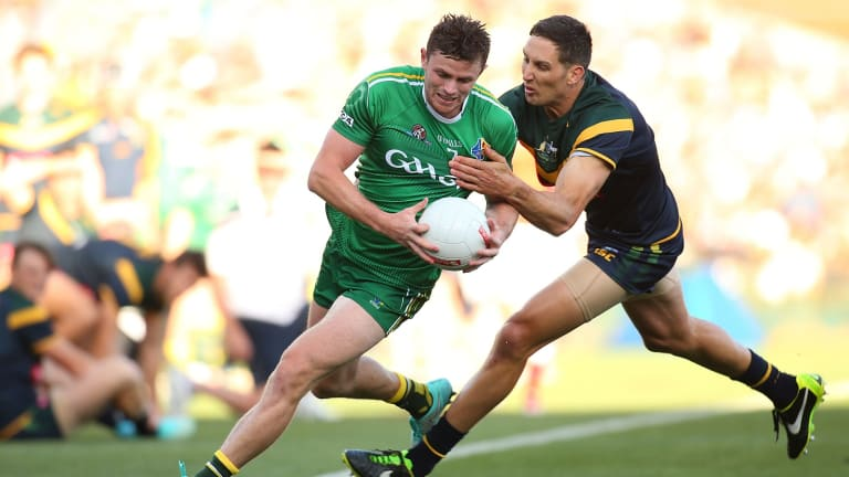 Harry Taylor of Australia tackles Pearce Hanley of Ireland during the international rules Test in Perth last year.