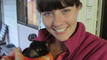 Biologist Emma Peel with a young Tasmanian devil.