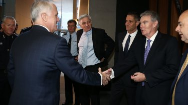 Prime Minister Malcolm Turnbull greets ASIO director-general Duncan Lewis earlier this month.