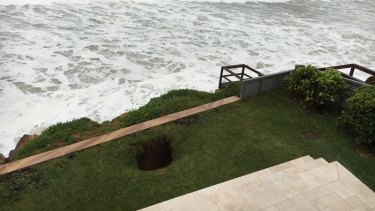 A sinkhole has opened on the lawn in front of Brian Vegh's Collaroy unit.