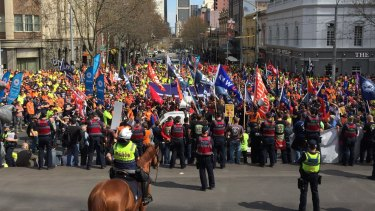 Thosands of workers rally in Melbourne's CBD to show their support for sacked CUB workers