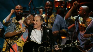The group on stage with Paul Simon in 2007.