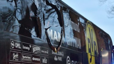 The blast damaged a window, spreading shrapnel over players and injuring one.