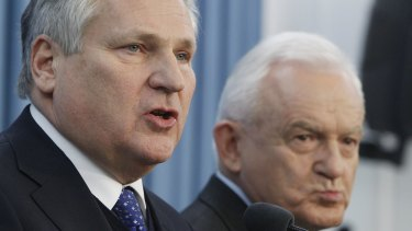 Denies knowing of mistreatment: Former Polish president Aleskander Kwasniewski speaks to reporters in Warsaw about the report on the CIA program that involved the torture of detainees in Poland. To his right is former prime minister Leszek Miller.