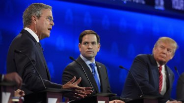 """""""Establishment"""" candidates Jeb Bush, left, and Marco Rubio, centre, argue a point as Donald Trump looks on during a Republican presidential debate last month."""