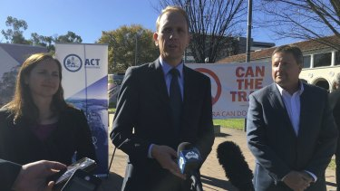 Capital Metro Minister Simon Corbell (centre) announces the signing of contracts, with Canberra Metro consortium chief executive Martin Pugh.