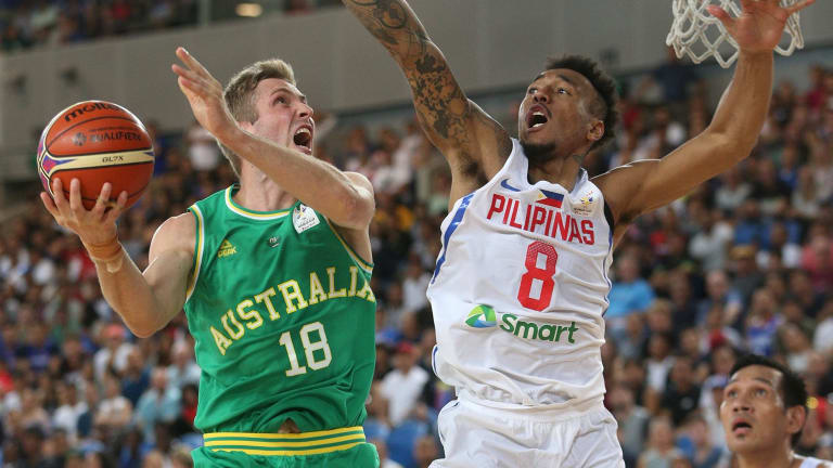 Jesse Wagstaff attempts to score under pressure from Calvin Abueva of Philippines during the FIBA World Cup qualifier match at Margaret Court Arena, on  Thursday.