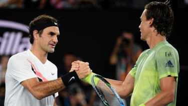 Switzerland's Roger Federer, left, is congratulated by Tomas Berdych of the Czech Republic after winning their quarter-final at the Australian Open  on Wednesday. Photo: Andy Brownbill, AP