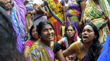Women mourn the death of their relative who died in Bihar, India after a wall collapsed in Tuesday's 7.3-magnitude earthquake in neighbouring Nepal.