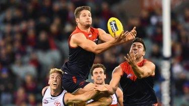 High-flyer: Demon Jesse Hogan throws himself at the football.
