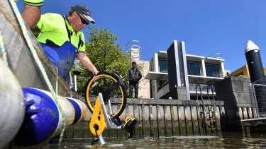 An oBike is pulled from the Yarra River on Monday.