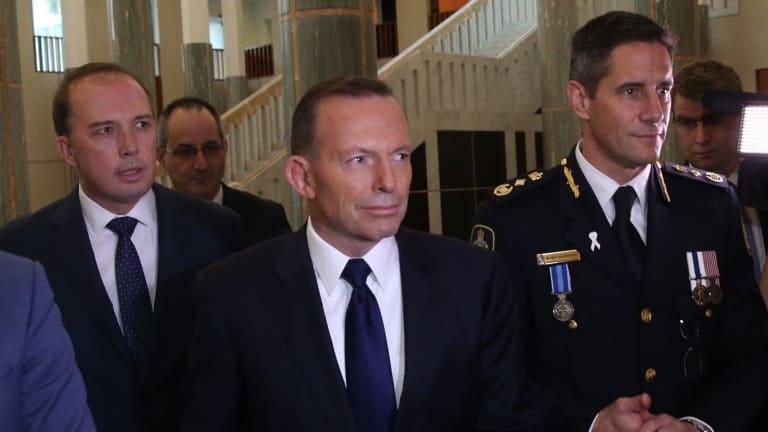 Immigration Minister Peter Dytton, Prime Minister Tony Abbott and Australian Border Force Commissioner Roman Quaedvlieg.