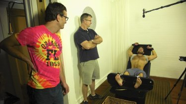 David Farrier, Richard Ivey and a tickle subject in <i>Tickled</i>.