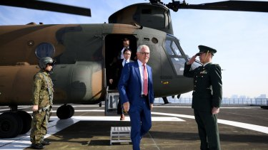 Australian Prime Minister Malcolm Turnbull disembarks a JGSDF Chinook helicopter at the Japanese Ministry of Defence in Tokyo after meeting with Japanese Prime Minister Shinzo Abe.