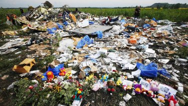 Flowers and mementos placed at the crash site of Malaysia Airlines Flight MH17 near the settlement of Rozspyne in Donetsk.