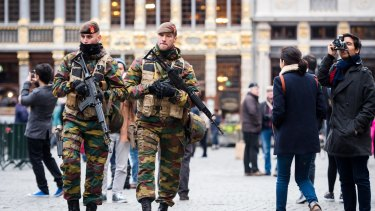 Belgian Army soldiers patrol in the picturesque Grand Place in the centre Brussels as the city goes into lockdown.