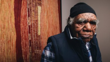Ray Ken, a senior Pitjantjatjara man and co-director of Tjala Arts in the APY lands, with his work Kulata Tjuta, 2015.