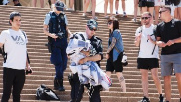 A police officer walks down the Sydney Opera House steps after the protest.