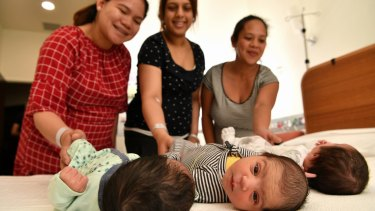 Baby Liam (left) with mum Awie Sajorda, a yet-to-be named baby (middle) with mum Gurpreet Paik, and baby Kloe (right) with mum Caroline Machete at Werribee Hospital.