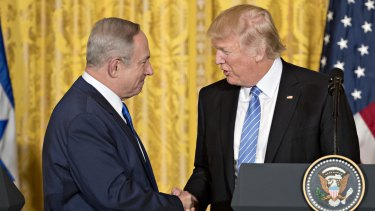 Trump, shaking hands with Israel's PM, says he is flexible with either a two-state or one-state solution in the Middle East.