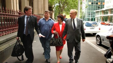 "Rob Stary (left) talks to the brother and parents of Joseph ""Jihad Jack"" Thomas outside Melbourne Supreme Court in December 2004."
