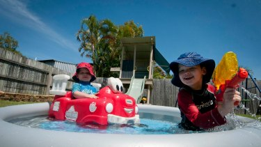 Three-year-old Daniel (left) and five-year-old Matthew (right) escaping the heat wave and enjoying the paradise of their mini pool at Alexandria Hills.