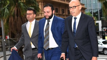 Moses Obeid, right, arrives at the NSW Supreme Court in Sydney with his legal team on Friday.