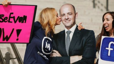 A voter pretends to kiss a cardboard cutout of Evan McMullin at a rally in Salt Lake City.