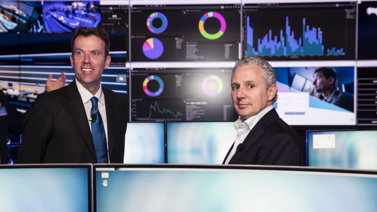 Dan Tehan, Minister Assisting the Prime Minister for Cyber Security and Telstra chief executive Andrew Penn at the opening of Telstra's first Security Operation Centre in Sydney last year.