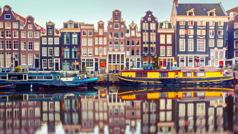 Advertising campaigns focus on the city's famous canals and art museums but locals say the city's free-wheeling and edgy spirit has been killed off as expats flood in.