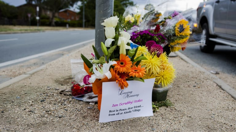 The growing roadside memorial for Ian Stokes.