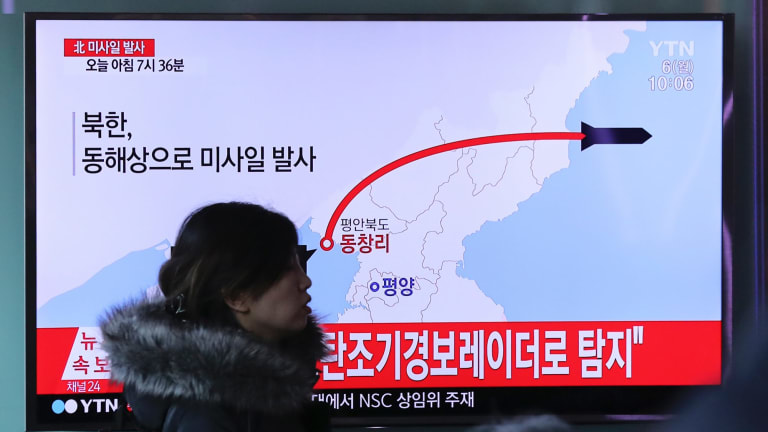 A TV news program reports North Korea's recent missile launch in Seoul, South Korea.
