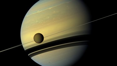 Saturn and its biggest moon Titan from NASA's Cassini spacecraft.