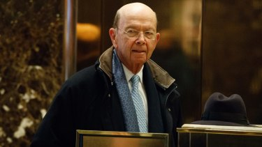 Commerce Secretary-designate Wilbur Ross waits for an elevator at Trump Tower in New York.