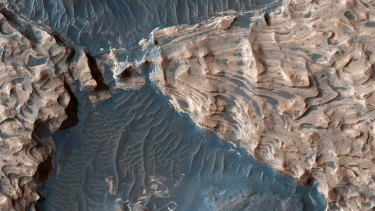 This image from NASA's Mars Reconnaissance Orbiter shows an ancient impact crater. Scientists suggest it once held a lake.