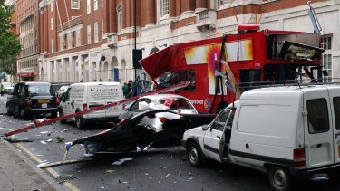 A wrecked double-decker London bus, with its roof blown off after a blast in London.